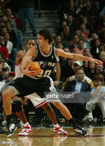 Manu Ginobili of the San Antonio Spurs is guarded by Chris Duhon of the Chicago Bulls during the first quarter at the United Center November 7 2005...