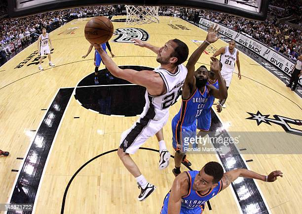 Manu Ginobili of the San Antonio Spurs lays the ball up against Thabo Sefolosha of the Oklahoma City Thunder in Game One of the Western Conference...