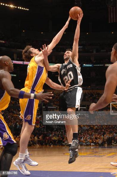 Manu Ginobili of the San Antonio Spurs lays up a shot against Pau Gasol of the Los Angeles Lakers in Game Five of the Western Conference Finals...