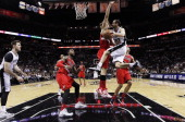 Manu Ginobili of the San Antonio Spurs leaps past Robin Lopez of the Portland Trail Blazers in Game Five of the Western Conference Semifinals during...
