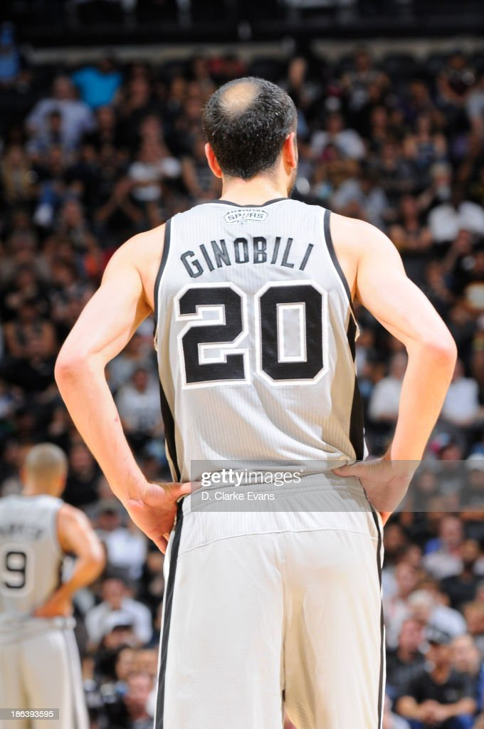 Manu Ginobili #20 of the San Antonio Spurs looks on during the game against the Memphis Grizzlies at the AT&T Center on October 30, 2013 in San Antonio, Texas.