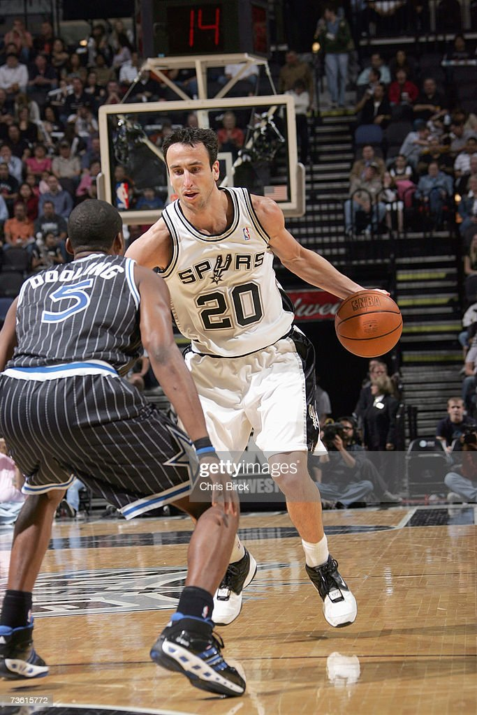 Manu Ginobili #20 of the San Antonio Spurs looks to move against Keyon Dooling #5 of the Orlando Magic at AT&T Center on March 2, 2007 in San Antonio, Texas. The Spurs won 98-74.