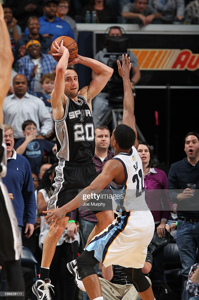 Manu Ginobili #20 of the San Antonio Spurs looks to pass the ball against Rudy Gay #22 of the Memphis Grizzlies on January 11, 2013 at FedExForum in Memphis, Tennessee.