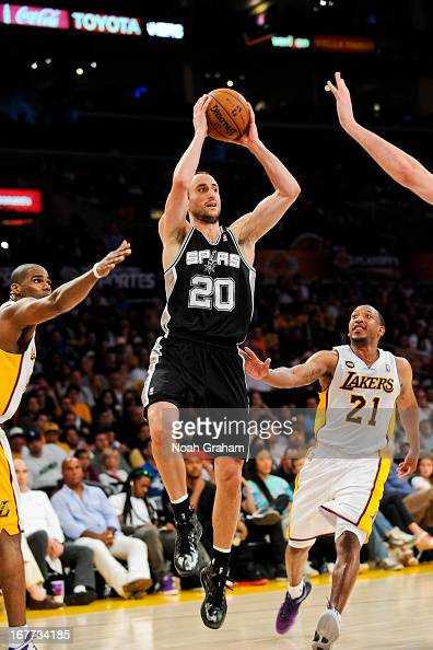 Manu Ginobili of the San Antonio Spurs looks to pass the ball against the Los Angeles Lakers in Game Four of the Western Conference Quarterfinals...