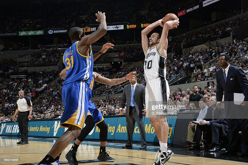 Manu Ginobili #20 of the San Antonio Spurs looks to pass while getting double covered against Festus Ezeli #31 of the Golden State Warriors on March 20, 2013 at the AT&T Center in San Antonio, Texas.