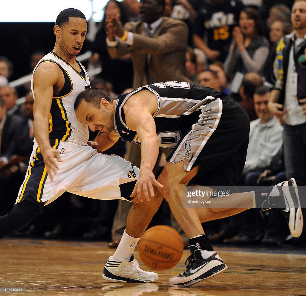 Manu Ginobili #20 of the San Antonio Spurs loses control of the ball and runs into <a gi-track='captionPersonalityLinkClicked' href=/galleries/search?phrase=Devin+Harris&family=editorial&specificpeople=202195 ng-click='$event.stopPropagation()'>Devin Harris</a> #5 of the Utah Jazz during the fourth quarter of Game Four of the Western Conference Quarterfinals in the 2012 NBA Playoffs at EnergySolutions Arena on May 07, 2012 in Salt Lake City, Utah. The Spurs won the game 87-81 and swept the Jazz four games to zero.