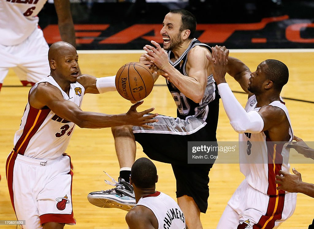 Manu Ginobili #20 of the San Antonio Spurs loses the ball as he drives between Ray Allen #34 and Dwyane Wade #3 of the Miami Heat in overtime during Game Six of the 2013 NBA Finals at AmericanAirlines Arena on June 18, 2013 in Miami, Florida.