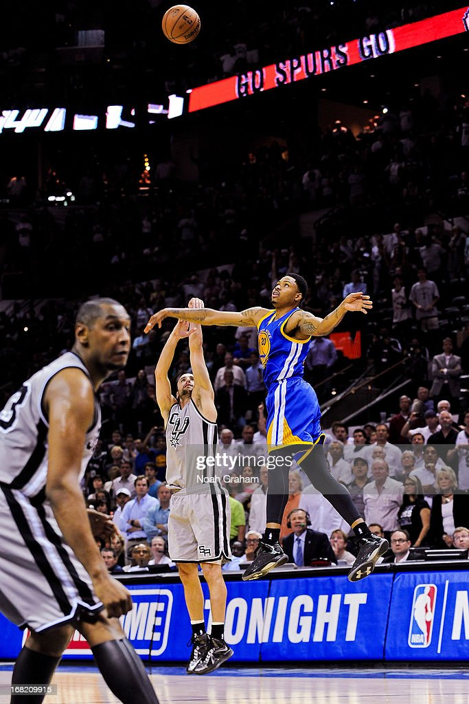 Manu Ginobili #20 of the San Antonio Spurs makes a go-ahead game-winning three-pointer against <a gi-track='captionPersonalityLinkClicked' href=/galleries/search?phrase=Kent+Bazemore&family=editorial&specificpeople=6846101 ng-click='$event.stopPropagation()'>Kent Bazemore</a> #20 of the Golden State Warriors in double overtime (2OT) in Game One of the Western Conference Semifinals during the 2013 NBA Playoffs on May 6, 2013 at the AT&T Center in San Antonio, Texas.