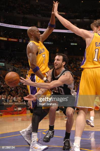 Manu Ginobili of the San Antonio Spurs makes a pass between the defense of Lamar Odom and Pau Gasol of the Los Angeles Lakers in Game Five of the...