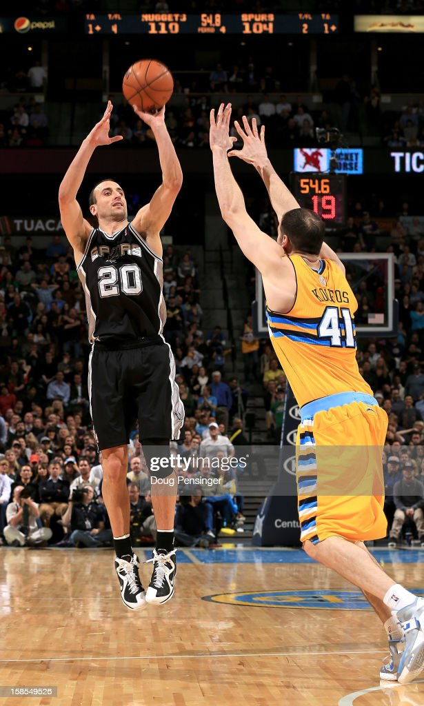 Manu Ginobili #20 of the San Antonio Spurs makes a two point shot over <a gi-track='captionPersonalityLinkClicked' href=/galleries/search?phrase=Kosta+Koufos&family=editorial&specificpeople=4216032 ng-click='$event.stopPropagation()'>Kosta Koufos</a> #41 of the Denver Nuggets at the Pepsi Center on December 18, 2012 in Denver, Colorado. The play was reviewed on video as the Nuggets defeated the Spurs 112-106.