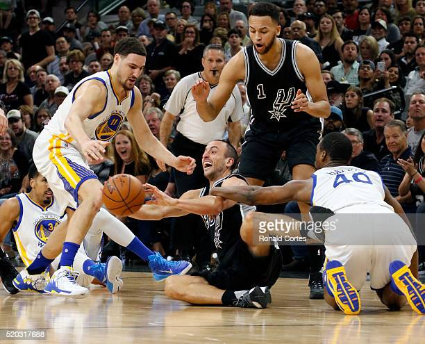 Manu Ginobili of the San Antonio Spurs outhustles Harrison Barnes of the Golden State Warriors for a loose ball at ATT Center on April 10 2016 in San...