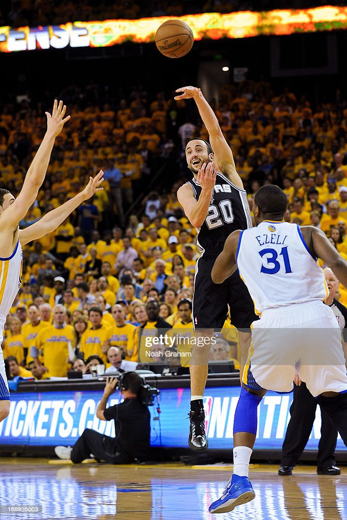 Manu Ginobili #20 of the San Antonio Spurs passes the ball against Festus Ezeli #31 of the Golden State Warriors in Game Six of the Western Conference Semifinals during the 2013 NBA Playoffs on May 16, 2013 at Oracle Arena in Oakland, California.