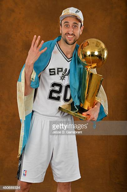Manu Ginobili of the San Antonio Spurs poses for a portrait with the Larry O'Brien Trophy after defeating the Miami Heat in Game Five of the 2014 NBA...