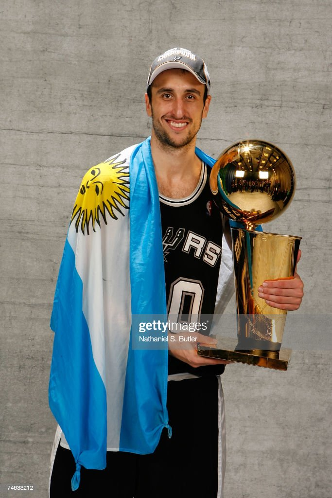 Manu Ginobili #20 of the San Antonio Spurs poses for a portrait with the Larry O'Brien Championship trophy after they won the 2007 NBA Championship with their 83-82 win against the Cleveland Cavaliers in Game Four of the NBA Finals at the Quicken Loans Arena on June 14, 2007 in Cleveland, Ohio.