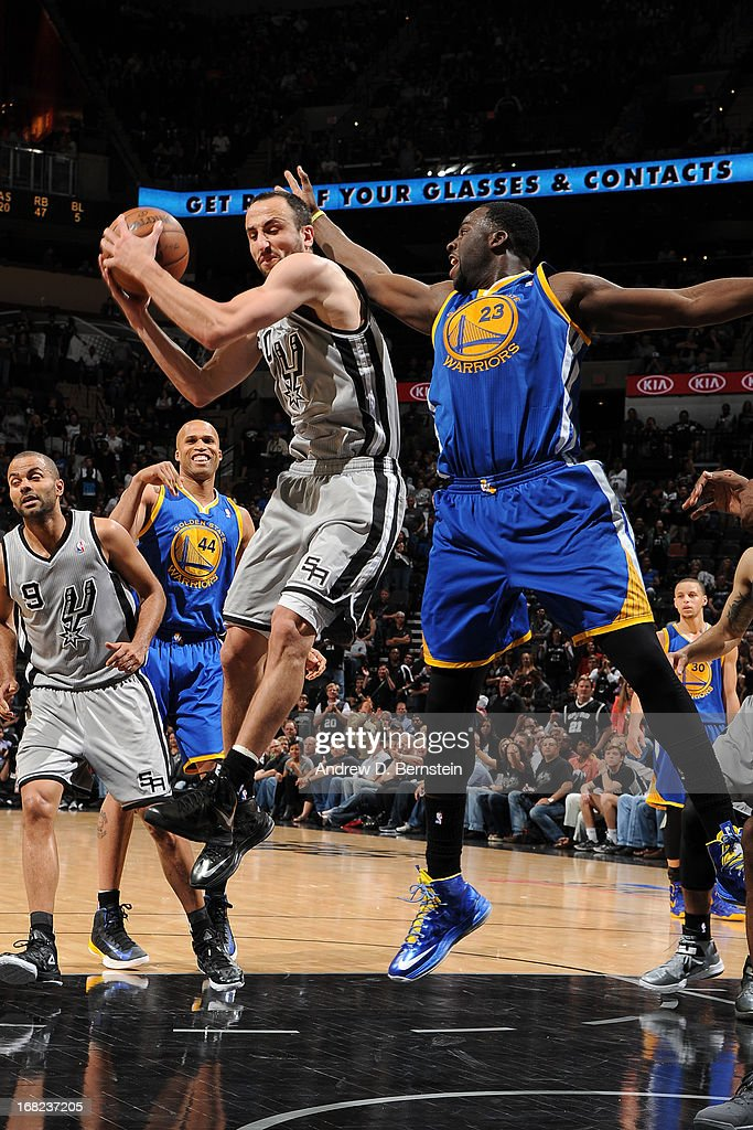 Manu Ginobili #20 of the San Antonio Spurs protects the ball against Draymond Green #23 of the Golden State Warriors in Game One of the Western Conference Semifinals during the 2013 NBA Playoffs on May 6, 2013 at the AT&T Center in San Antonio, Texas.