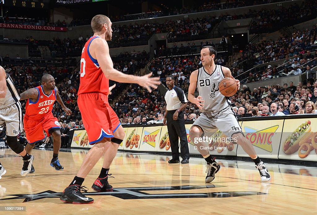Manu Ginobili #20 of the San Antonio Spurs protects the ball during the game between the Philadelphia 76ers and the San Antonio Spurs on January 5, 2013 at the AT&T Center in San Antonio, Texas.