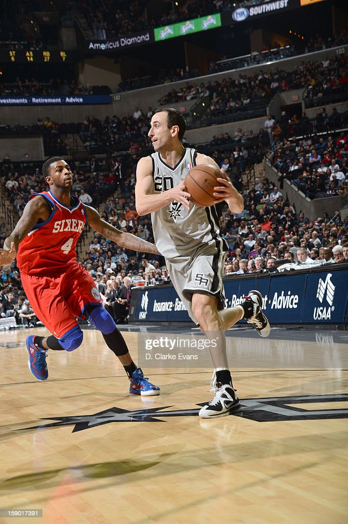 Manu Ginobili #20 of the San Antonio Spurs protects the ball from Dorell Wright #4 of the Philadelphia 76ers during the game between the Philadelphia 76ers and the San Antonio Spurs on January 5, 2013 at the AT&T Center in San Antonio, Texas.