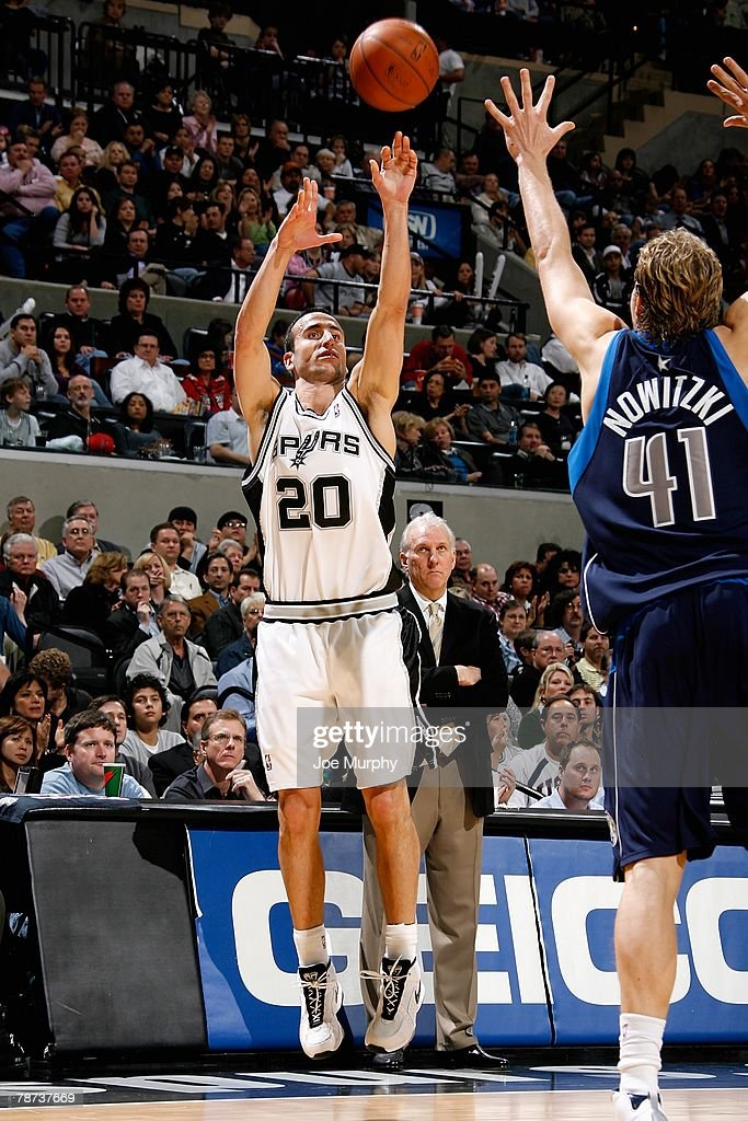 Manu Ginobili #20 of the San Antonio Spurs puts a shot up over Dirk Nowitzki #41 of the Dallas Mavericks during the game on December 5, 2007 at the AT&T Center in San Antonio, Texas. The Spurs won 97-95.