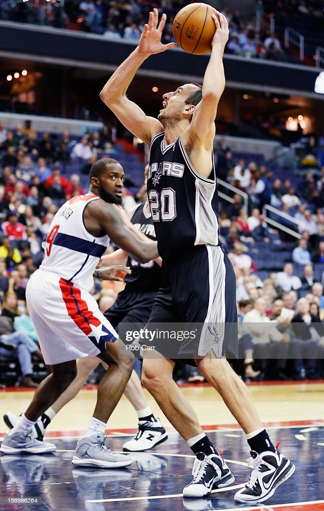 Manu Ginobili #20 of the San Antonio Spurs puts up a shot in front of <a gi-track='captionPersonalityLinkClicked' href=/galleries/search?phrase=Martell+Webster&family=editorial&specificpeople=601785 ng-click='$event.stopPropagation()'>Martell Webster</a> #9 of the Washington Wizards during the second half of the Spurs 118-92 win at Verizon Center on November 26, 2012 in Washington, DC.