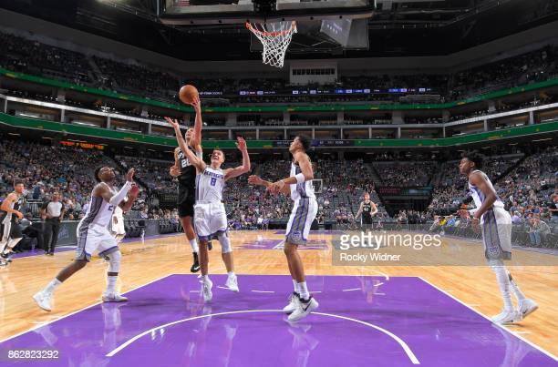 Manu Ginobili of the San Antonio Spurs rebounds against Bogdan Bogdanovic of the Sacramento Kings on October 2 2017 at Golden 1 Center in Sacramento...