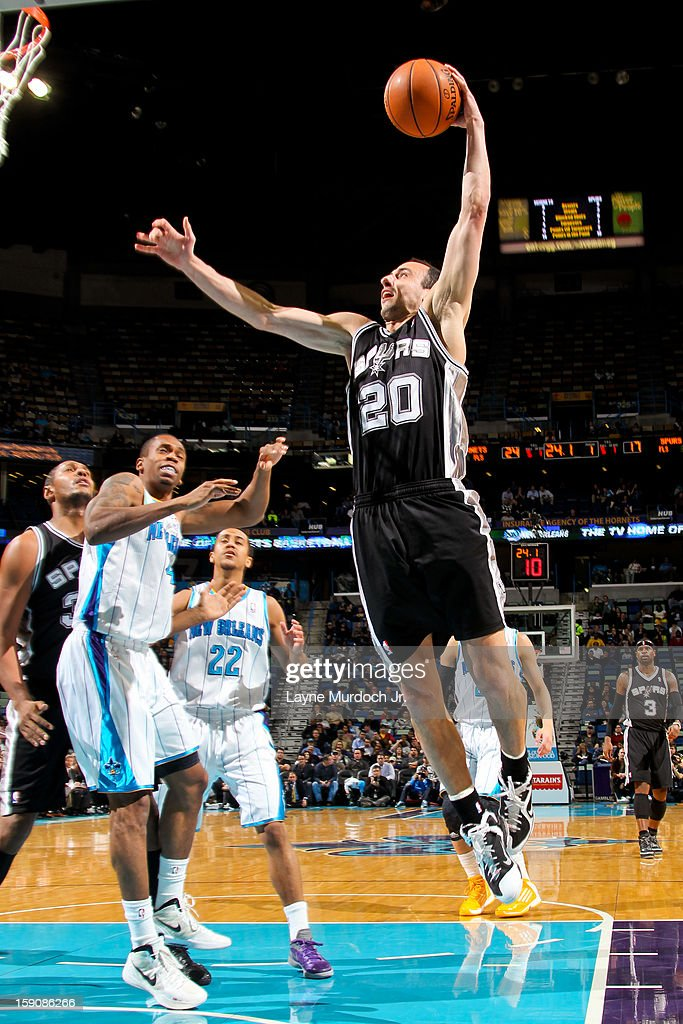 Manu Ginobili #20 of the San Antonio Spurs rises for a dunk against the New Orleans Hornets on January 7, 2013 at the New Orleans Arena in New Orleans, Louisiana.