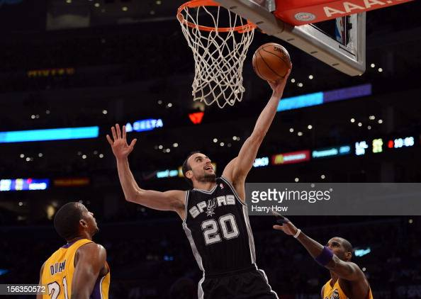 Manu Ginobili of the San Antonio Spurs scores on a layup between Chris Duhon and Antawn Jamison of the Los Angeles Lakers at Staples Center on...