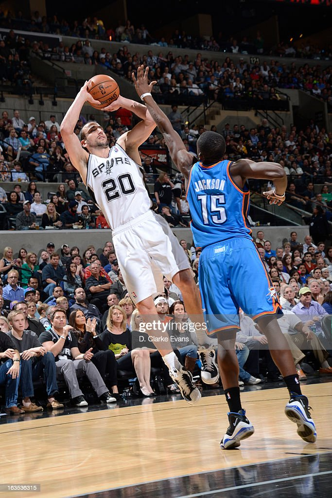 Manu Ginobili #20 of the San Antonio Spurs shoots a fade away against Reggie Jackson #15 of the Oklahoma City Thunder on March 11, 2013 at the AT&T Center in San Antonio, Texas.