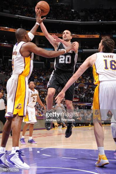 Manu Ginobili of the San Antonio Spurs shoots a layup against Antawn Jamison of the Los Angeles Lakers in Game Four of the Western Conference...