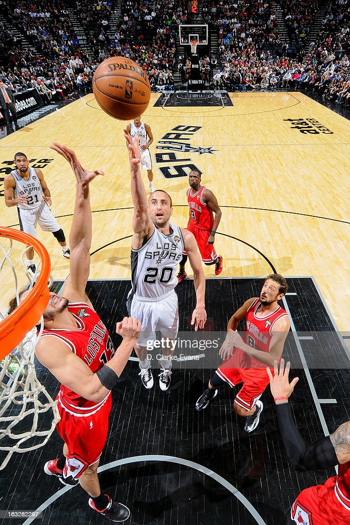 Manu Ginobili #20 of the San Antonio Spurs shoots a layup against <a gi-track='captionPersonalityLinkClicked' href=/galleries/search?phrase=Joakim+Noah&family=editorial&specificpeople=699038 ng-click='$event.stopPropagation()'>Joakim Noah</a> #13 of the Chicago Bulls on March 6, 2013 at the AT&T Center in San Antonio, Texas.