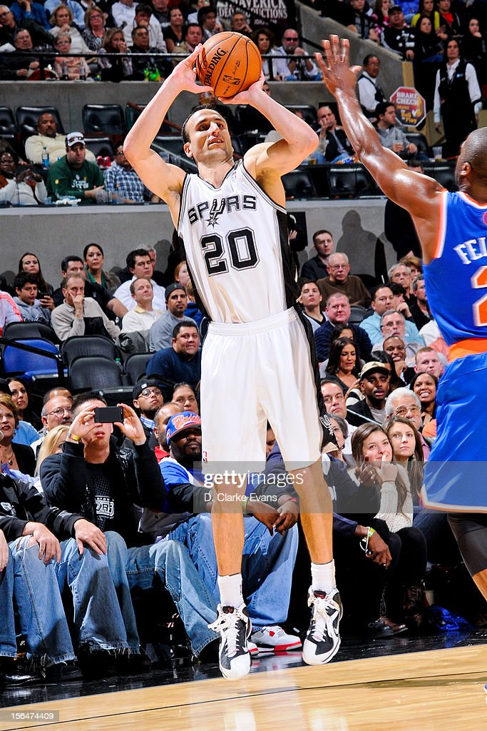 Manu Ginobili #20 of the San Antonio Spurs shoots a three-pointer against the New York Knicks on November 15, 2012 at the AT&T Center in San Antonio, Texas.