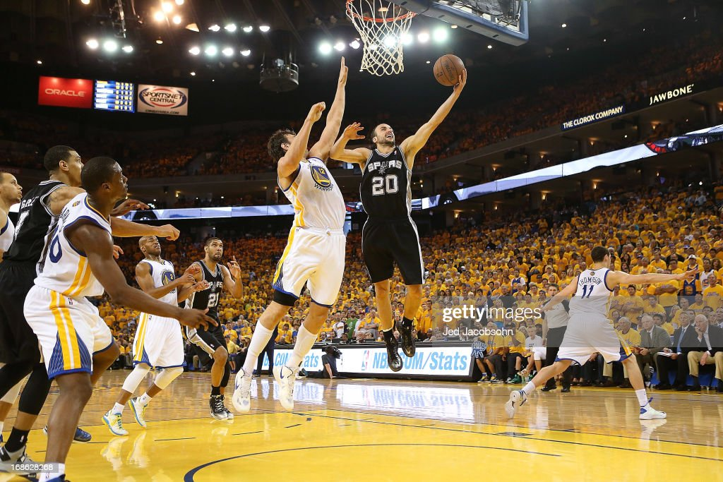 Manu Ginobili #20 of the San Antonio Spurs shoots against <a gi-track='captionPersonalityLinkClicked' href=/galleries/search?phrase=Andrew+Bogut&family=editorial&specificpeople=207105 ng-click='$event.stopPropagation()'>Andrew Bogut</a> #12 of the Golden State Warriors in Game Four of the Western Conference Semifinals during the 2013 NBA Playoffs on May 12, 2013 at the Oracle Arena in Oakland, California.