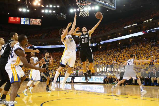 Manu Ginobili of the San Antonio Spurs shoots against Andrew Bogut of the Golden State Warriors in Game Four of the Western Conference Semifinals...