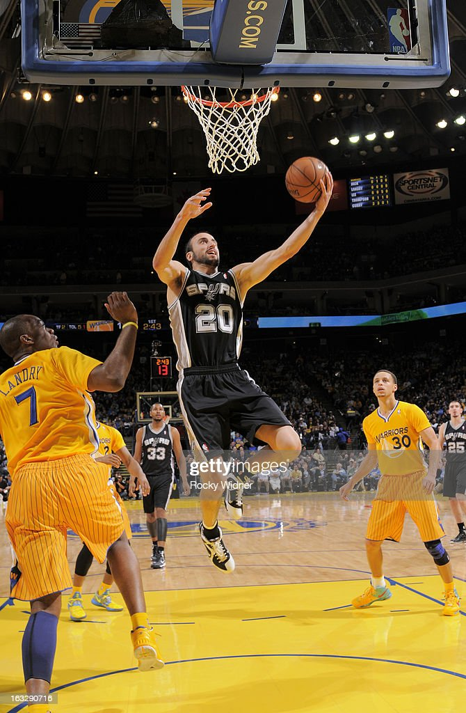 Manu Ginobili #20 of the San Antonio Spurs shoots against <a gi-track='captionPersonalityLinkClicked' href=/galleries/search?phrase=Carl+Landry&family=editorial&specificpeople=4111952 ng-click='$event.stopPropagation()'>Carl Landry</a> #7 of the Golden State Warriors on February 22, 2013 at Oracle Arena in Oakland, California.