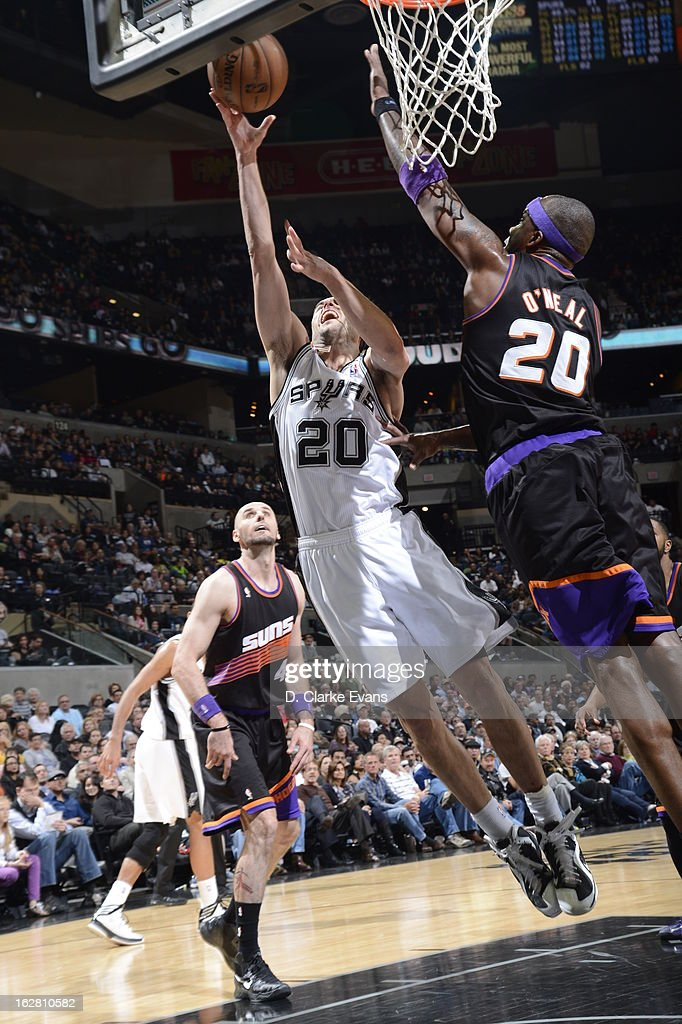 Manu Ginobili #20 of the San Antonio Spurs shoots against <a gi-track='captionPersonalityLinkClicked' href=/galleries/search?phrase=Jermaine+O%27Neal&family=editorial&specificpeople=201524 ng-click='$event.stopPropagation()'>Jermaine O'Neal</a> #20 of the Phoenix Suns on February 27, 2013 at the AT&T Center in San Antonio, Texas.