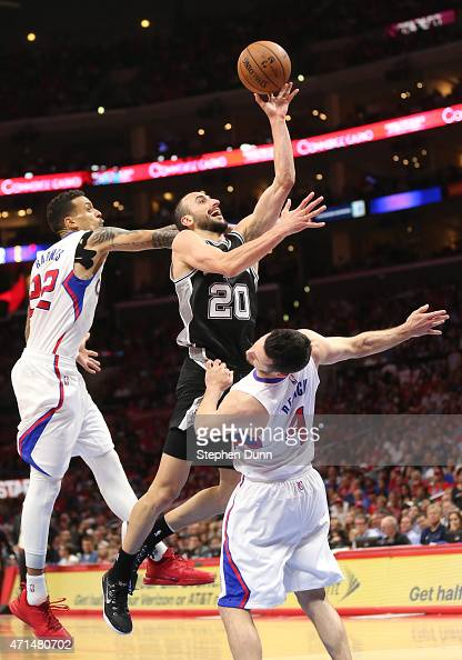 Manu Ginobili of the San Antonio Spurs shoots against JJ Redick # and Matt Barnes of the Los Angeles Clippers during Game Five of the Western...