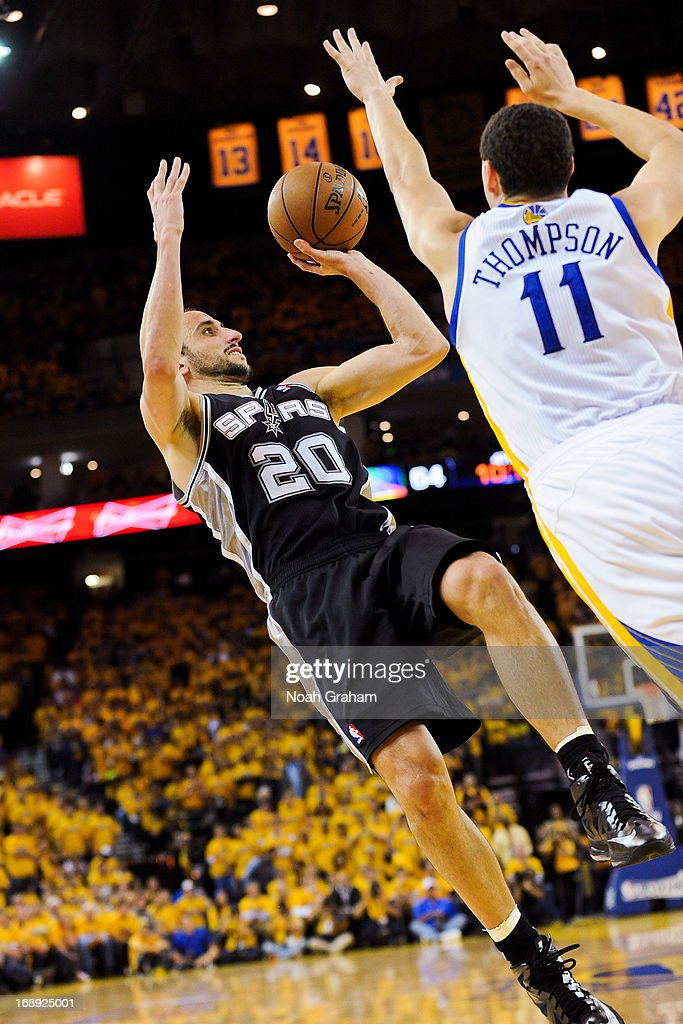 Manu Ginobili #20 of the San Antonio Spurs shoots against Klay Thompson #11 of the Golden State Warriors in Game Six of the Western Conference Semifinals during the 2013 NBA Playoffs on May 16, 2013 at Oracle Arena in Oakland, California.