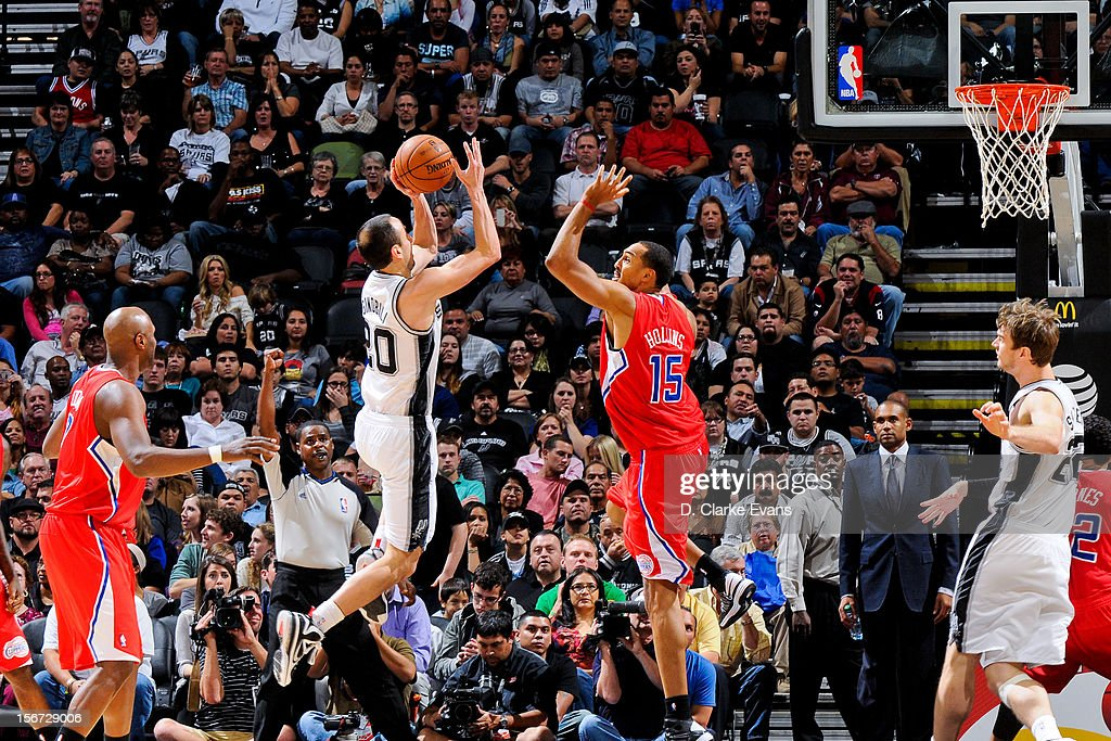 Manu Ginobili #20 of the San Antonio Spurs shoots against Ryan Hollins #15 of the Los Angeles Clippers on November 19, 2012 at the AT&T Center in San Antonio, Texas.