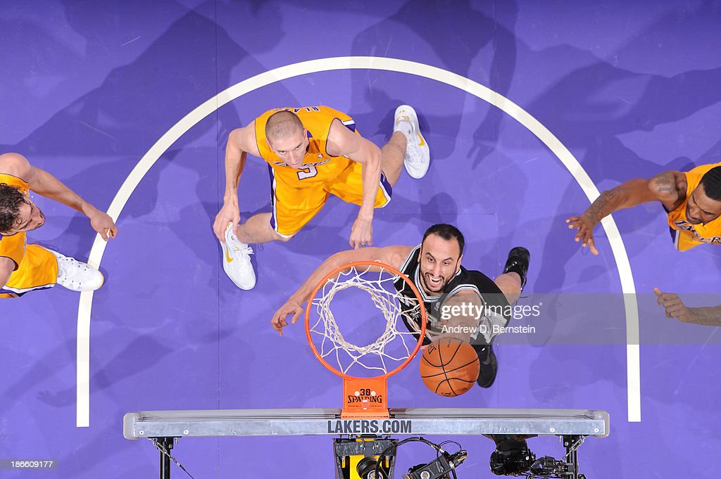 Manu Ginobili #20 of the San Antonio Spurs shoots against <a gi-track='captionPersonalityLinkClicked' href=/galleries/search?phrase=Steve+Blake+-+Basketball+Player&family=editorial&specificpeople=204474 ng-click='$event.stopPropagation()'>Steve Blake</a> #5 of the Los Angeles Lakers on November 1, 2013 at STAPLES Center in Los Angeles, California.
