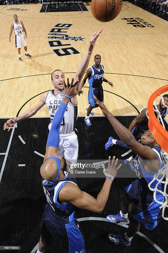 Manu Ginobili #20 of the San Antonio Spurs shoots against the Dallas Mavericks on March 14, 2013 at the AT&T Center in San Antonio, Texas.