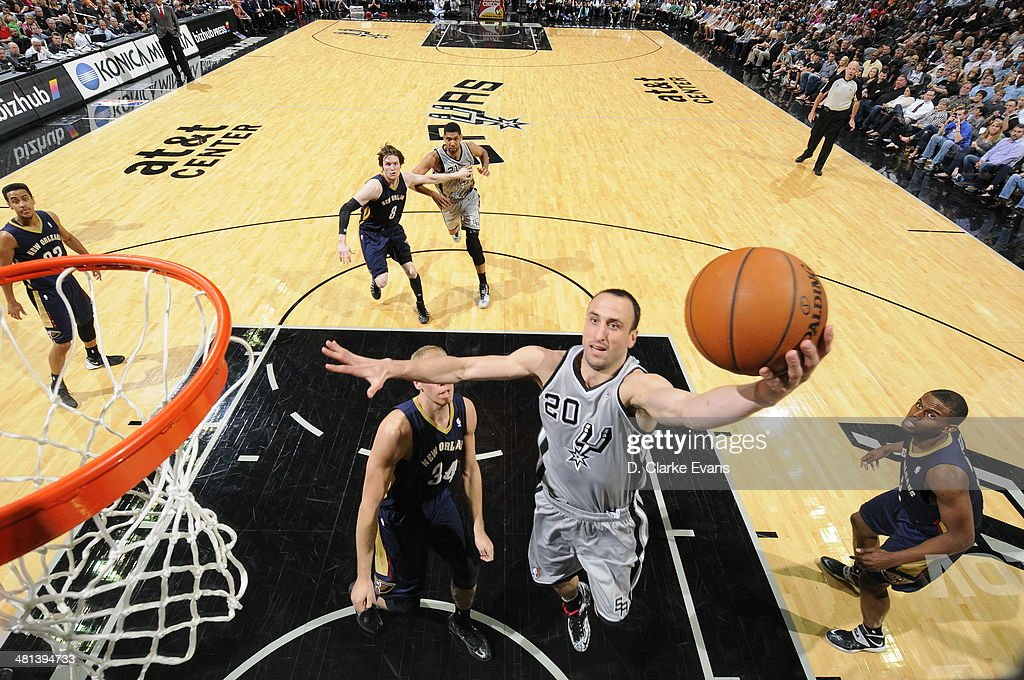 Manu Ginobili #20 of the San Antonio Spurs shoots against the New Orleans Pelicans at the AT&T Center on March 29, 2014 in San Antonio, Texas.