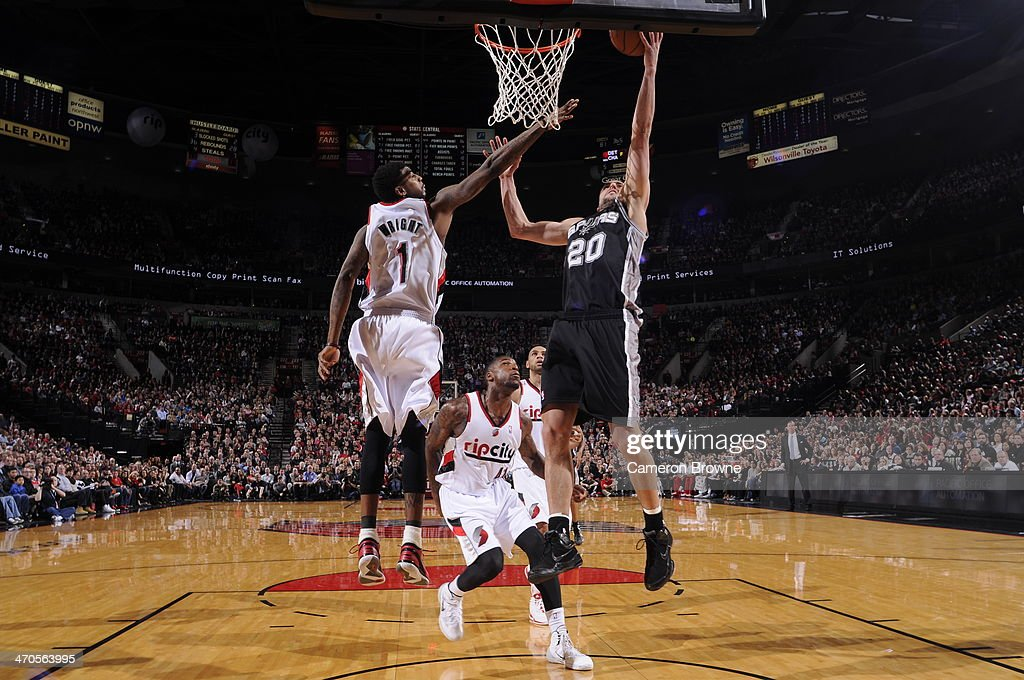 Manu Ginobili #20 of the San Antonio Spurs shoots against the Portland Trail Blazers on February 19, 2014 at the Moda Center Arena in Portland, Oregon.