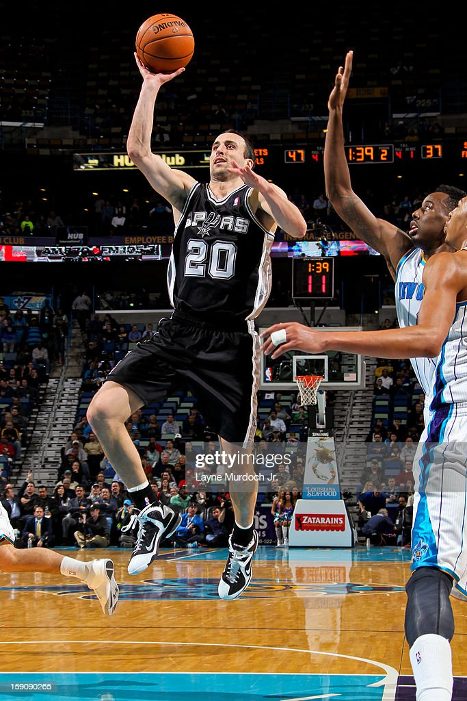 Manu Ginobili #20 of the San Antonio Spurs shoots in the lane against Al-Farouq Aminu #0 of the New Orleans Hornets on January 7, 2013 at the New Orleans Arena in New Orleans, Louisiana.