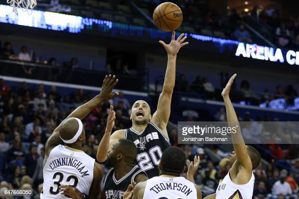 Manu Ginobili of the San Antonio Spurs shoots over Dante Cunningham of the New Orleans Pelicans Hollis Thompson and Tim Frazier during the first half...