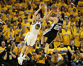 Manu Ginobili of the San Antonio Spurs shoots over Klay Thompson of the Golden State Warriors in Game Six of the Western Conference Semifinals during...