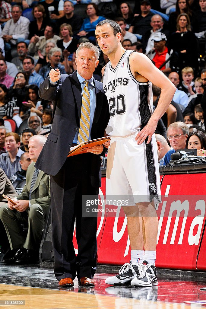 Manu Ginobili #20 of the San Antonio Spurs speaks with assistant coach Mike Budenholzer during a game against the Denver Nuggets on March 27, 2013 at the AT&T Center in San Antonio, Texas.
