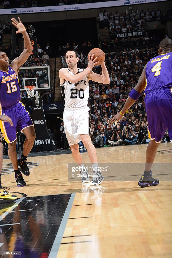 Manu Ginobili #20 of the San Antonio Spurs splits defense during the game between the Los Angeles Lakers and the San Antonio Spurs on January 9, 2013 at the AT&T Center in San Antonio, Texas.