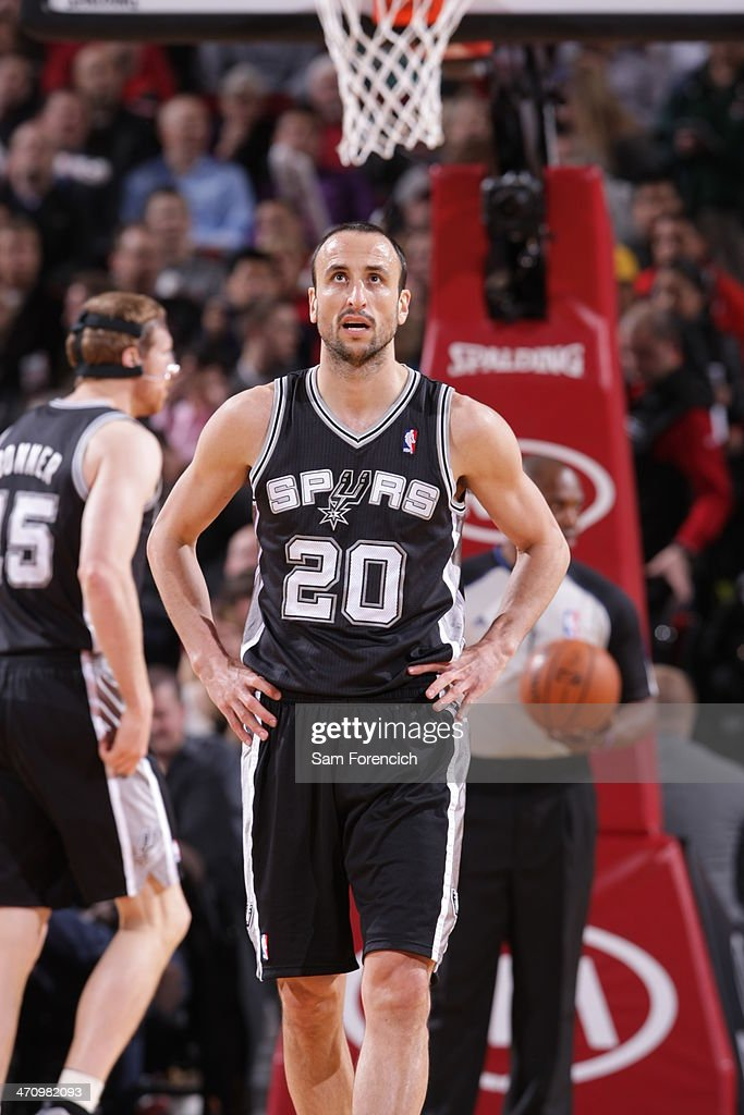 Manu Ginobili #20 of the San Antonio Spurs stands on the court against the Portland Trail Blazers on February 19, 2014 at the Moda Center Arena in Portland, Oregon.