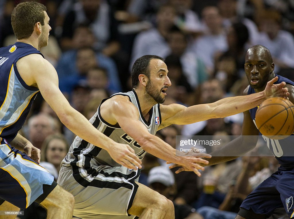 Manu Ginobili #20 of the San Antonio Spurs steals the ball from Quincy Pondexter #20 of the Memphis Grizzlies during a game on October 30, 2013 at the AT&T Center in San Antonio, Texas.