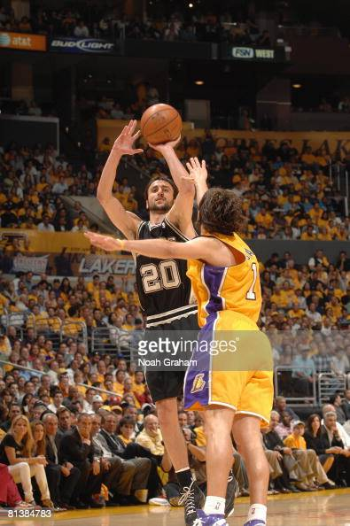 Manu Ginobili of the San Antonio Spurs takes a jump shot against Sasha Vujacic of the Los Angeles Lakers in Game Five of the Western Conference...