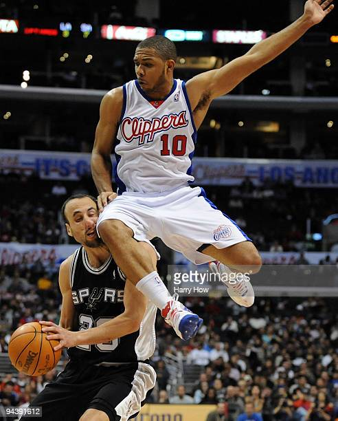 Manu Ginobili of the San Antonio Spurs takes a knee to the face from Eric Gordon of the Los Angeles Clippers at Staples Center on December 13 2009 in...